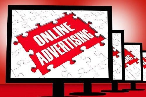 Online Advertising On Monitors Showing Marketing Strategies